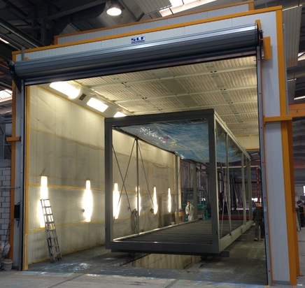 Combined paint spraying and drying booth for containers