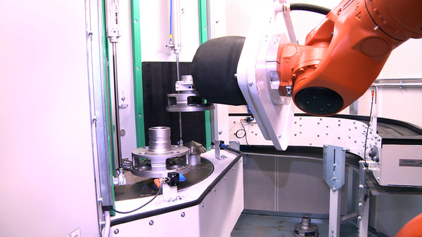 Pressure-blast automated blast machine with workpiece handling via robot