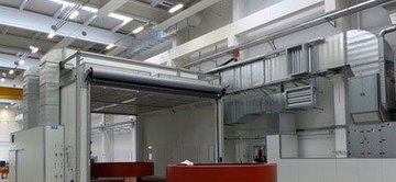 Paint spraying booths with drying function and floor extraction system