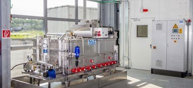 Process water treatment unit for cleaning booth